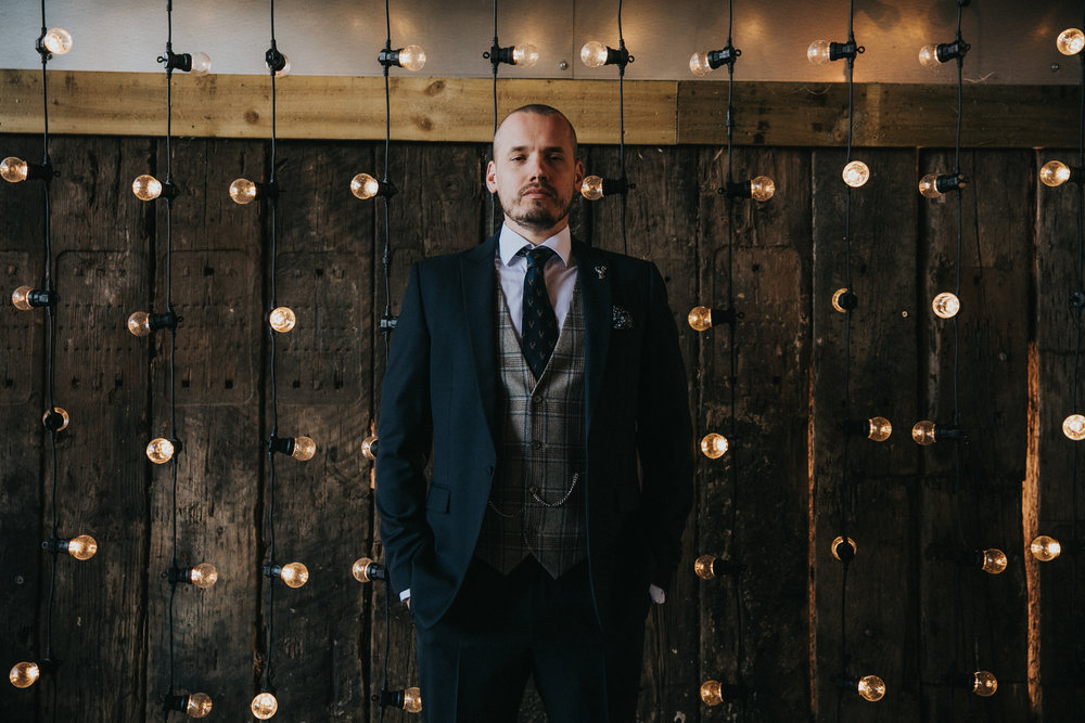 groom in front of lights