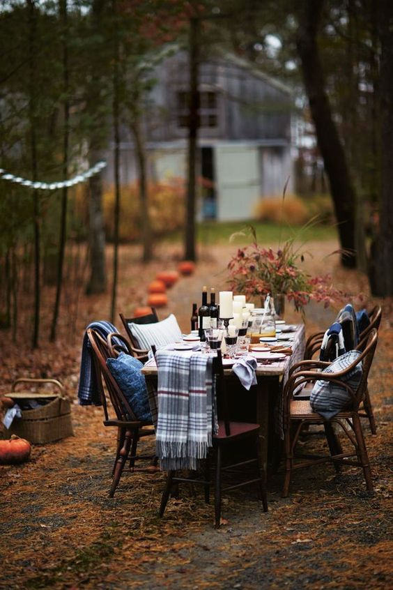We love this gorgeous outdoor fall dinner party from  Camille Styles  - those cozy blankets are perfect if the air gets chilly!