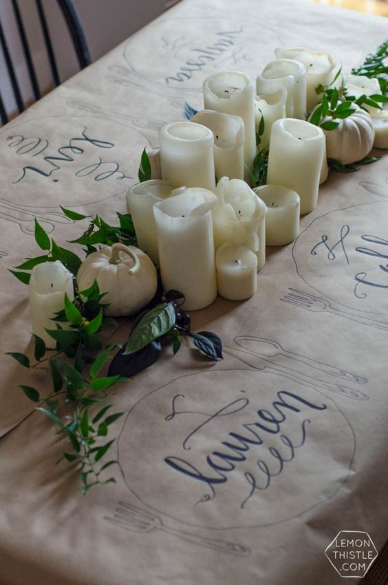 We're kind of in love with this inexpensive and crafty table runner idea from  Lemon Thistle !