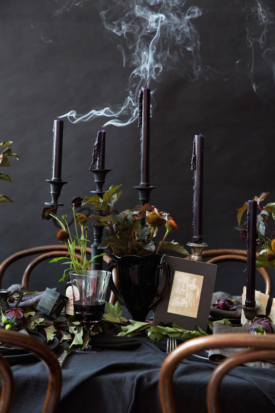 Just imagine spending the evening at this spookily glamorous table from  Camille Styles !