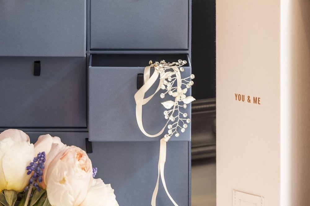 Wedding_Lifestyle_Blue_close_up_on_drawer_with_you_and_me_box_and_head_piece_sticking_out_1024x1024.jpg