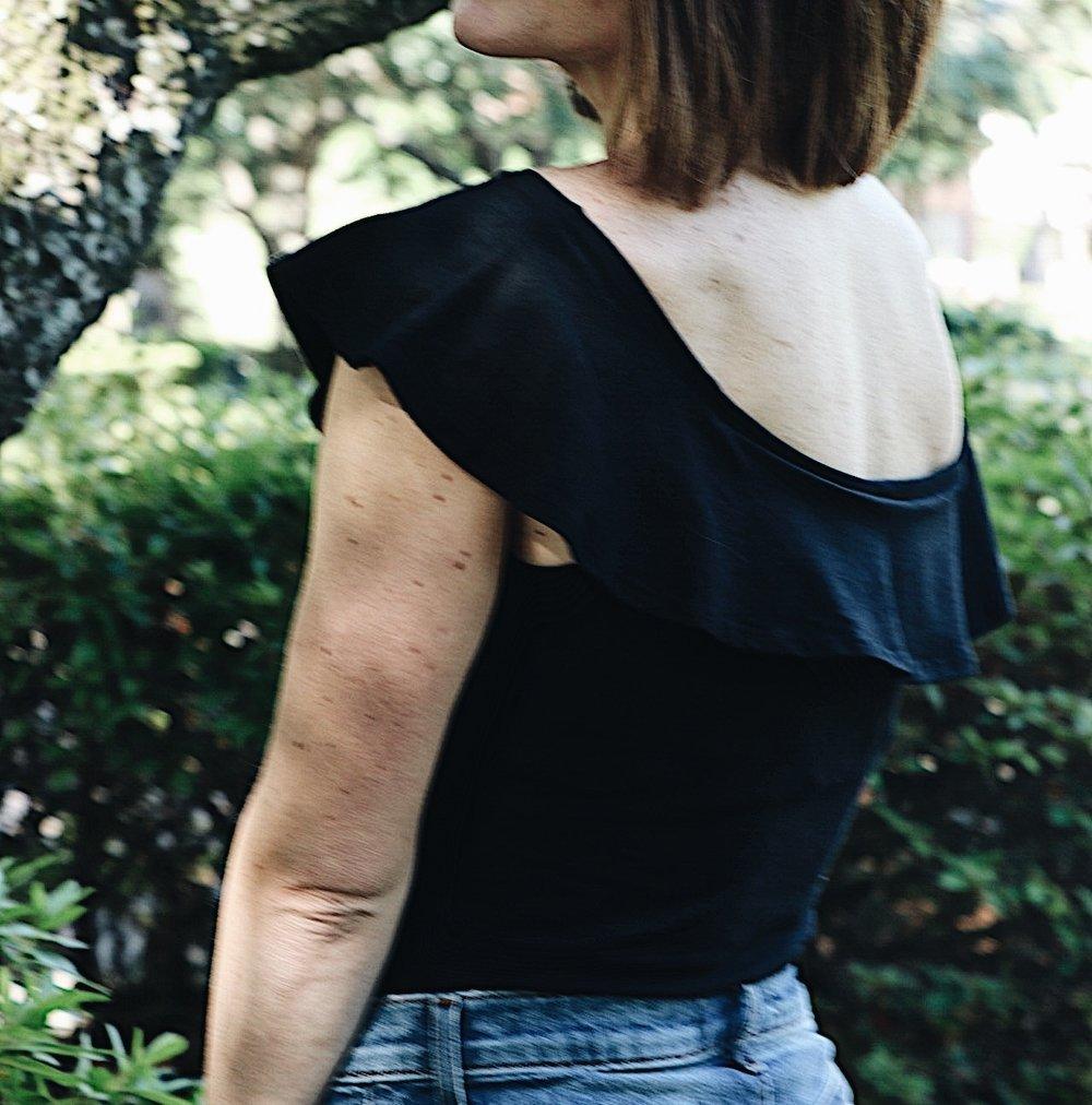 ruffled bodysuit, black bodysuit, classic style