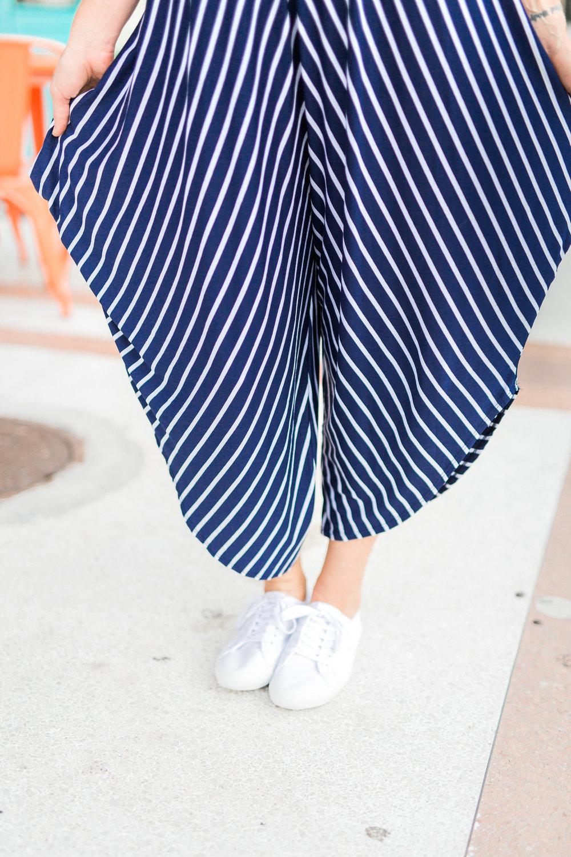 striped jumpsuit, mirrored aviators