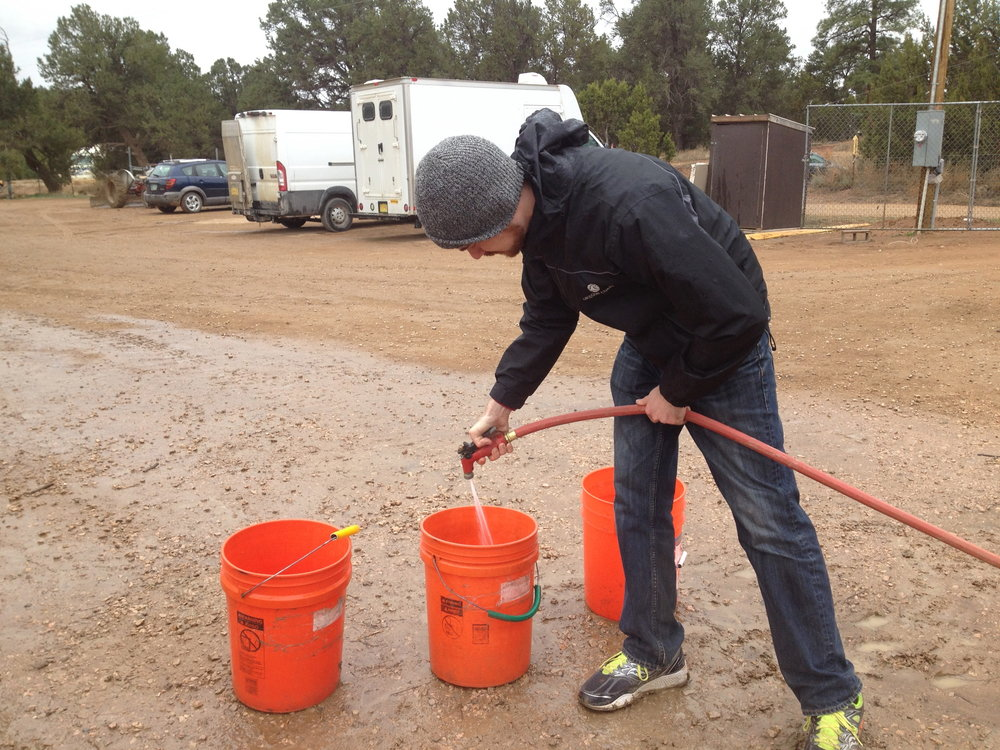 Our cousin Eric, visiting from NJ, washing food buckets after a Feeding Tour. Thanks, Eric!