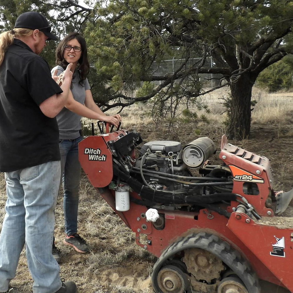 Above: Casey teaching Courtney how to use the trencher. Below (L to R): Girl Scout volunteers clearing brush. Nikki on the John Deere.