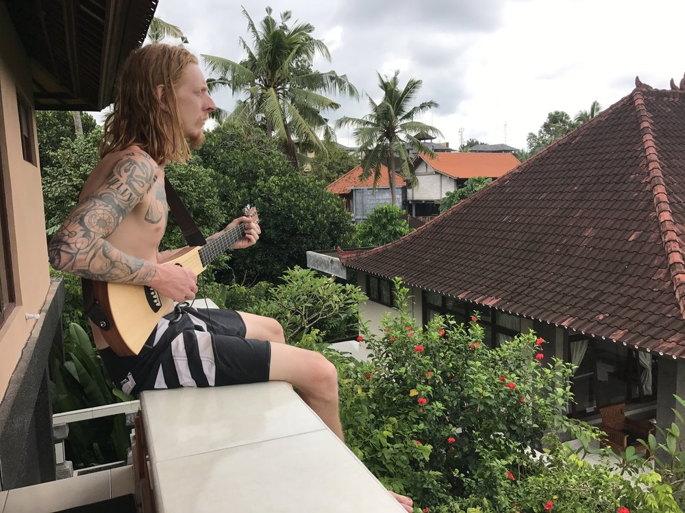 Chadley singing songs on the balcony at Bisma Jaya.