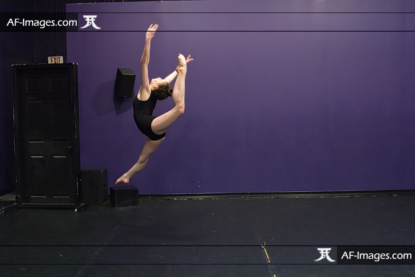 Dancer jumping in her studio, before retouching. Linthicum Heights, MD. (Copyright Angela Ferguson Photography)