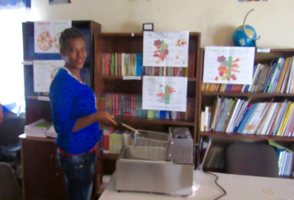 Handing over equipment to one of the livelihoods beneficiaries in Addis Ababa after the successful submittal of her business plan (1).jpg
