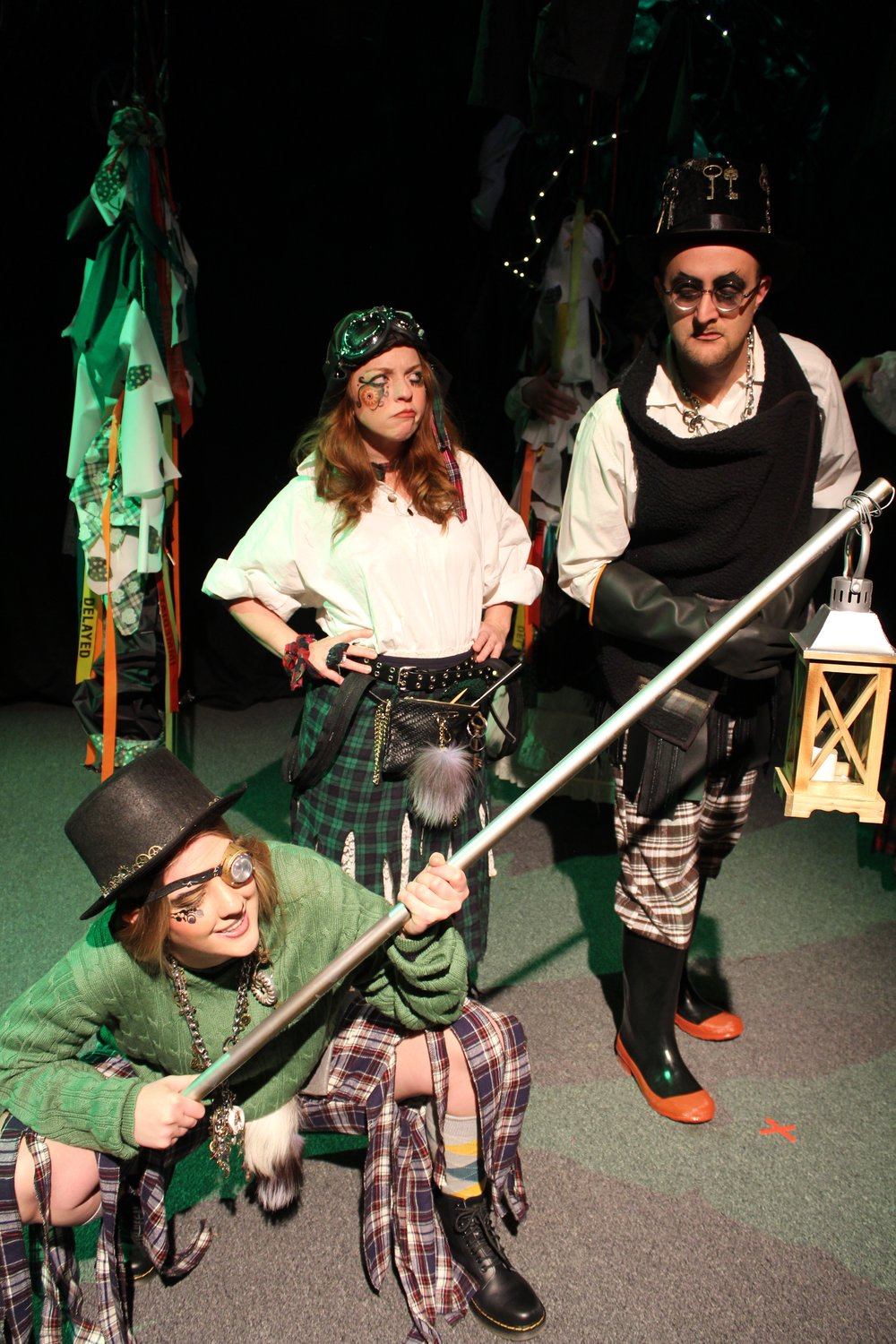 Hannah Carmichael  as The Minion,  Karin Carr  as The Lass, and  Ryan Barnett  as The Mischanter
