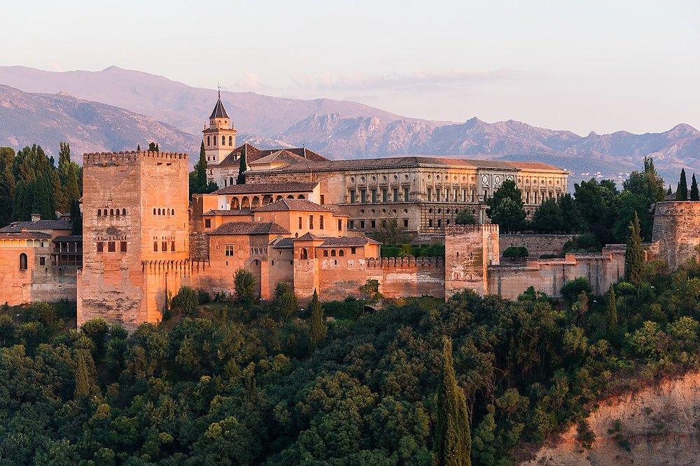 Alhambra (Qalat Al-Hamra). Granada, Spain (Andalusia)  https://upload.wikimedia.org/wikipedia/commons/thumb/d/de/Dawn_Charles_V_Palace_Alhambra_Granada_Andalusia_Spain.jpg/1200px-Dawn_Charles_V_Palace_Alhambra_Granada_Andalusia_Spain.jpg