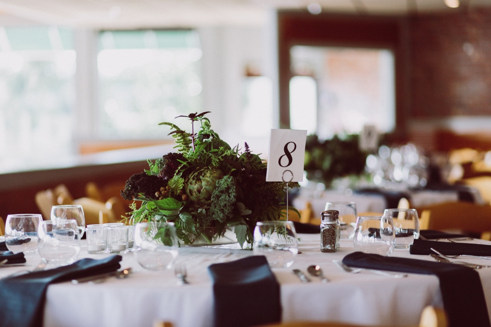 wedding table with edible kale themed certerpieces with herbs and berries