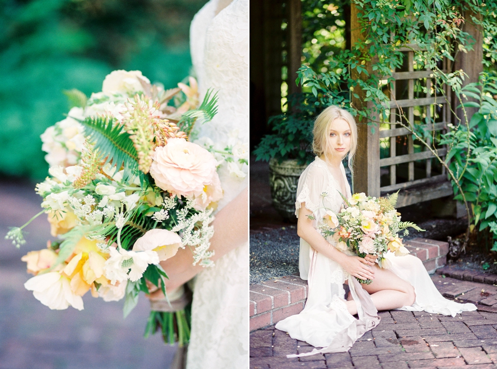 bride sitting with a yellow and pink rose bouquet with fern accents