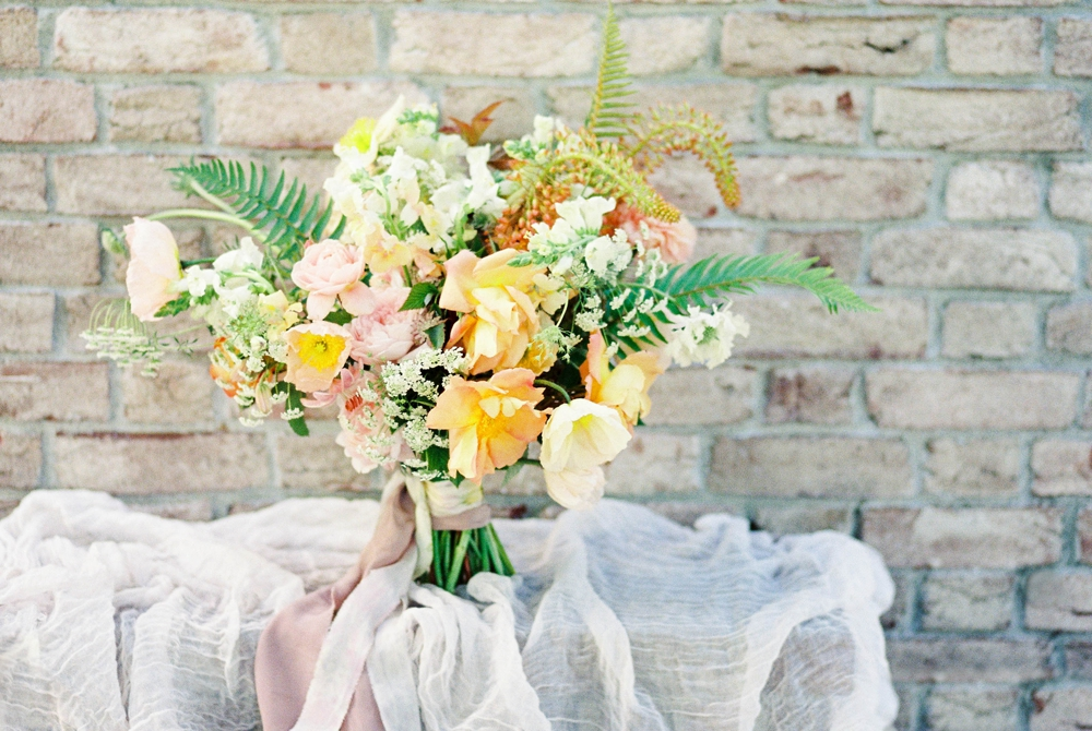 yellow and pink bouquet with fern accents
