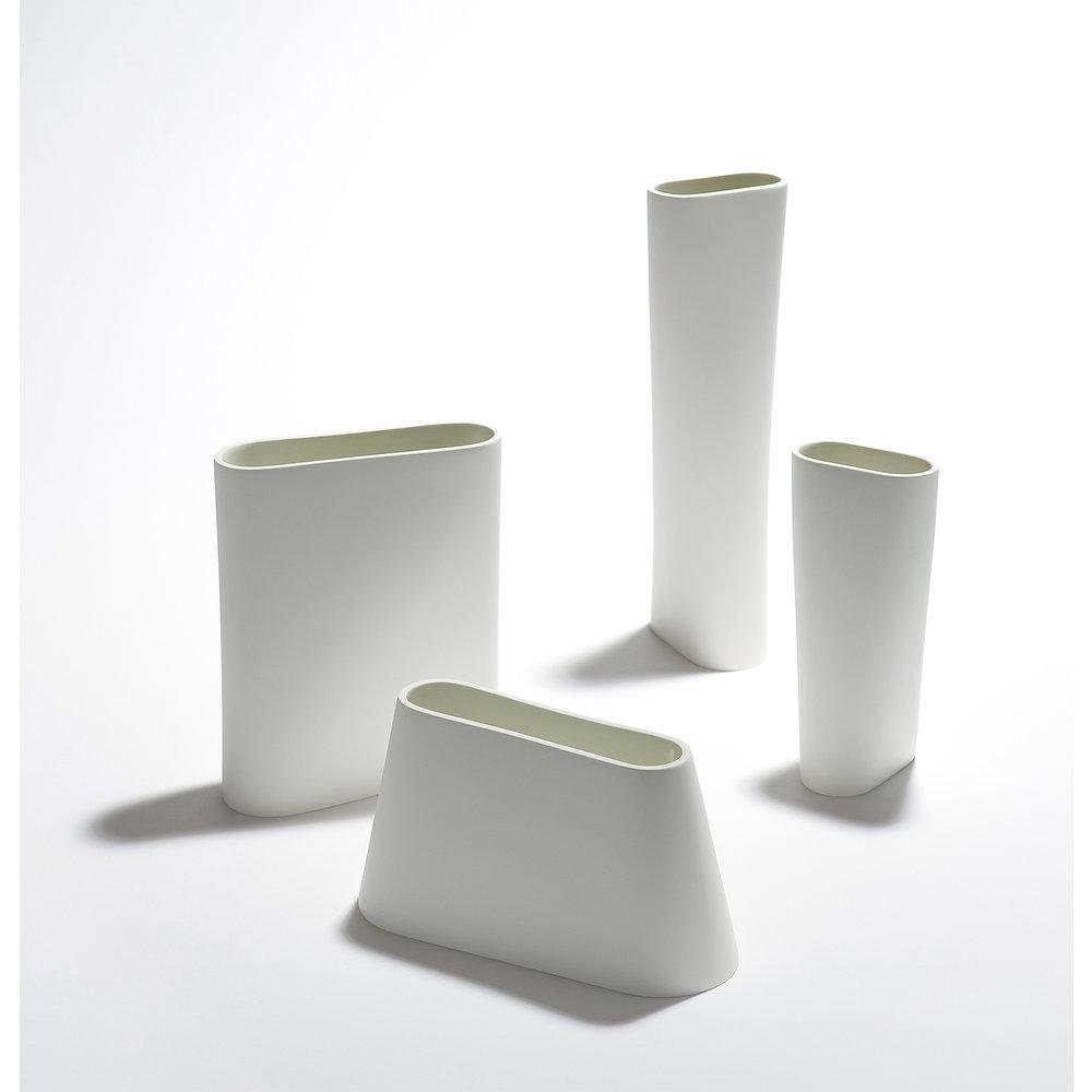 "EML  ""Oval Vase Series""  3.75 x 4.1 x 12 in  3.5 x 3.5 x 7.5 in  2.75 x 6.75 x 8 in  3.25 x 8.5 x 4.5 in"