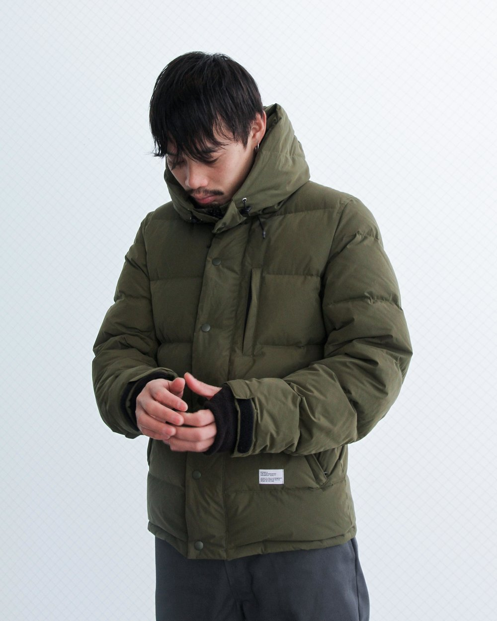 """Tadashi wears: """"QUINE"""" Hooded down jacket. Available in Olive, Black and Blue."""