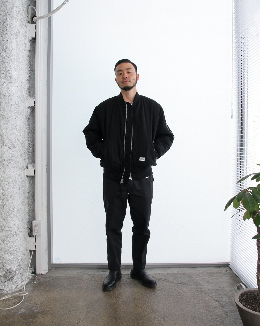 """Ryo wears: """"DUFFY"""" a reversible MA-1 jacket available in black/orange or black/red (in-store exclusive)"""