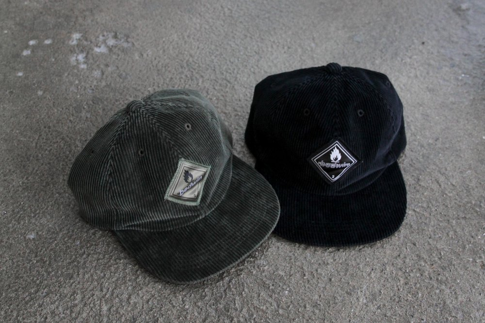 """""""GREG"""" Corduroy cap available in black or olive."""