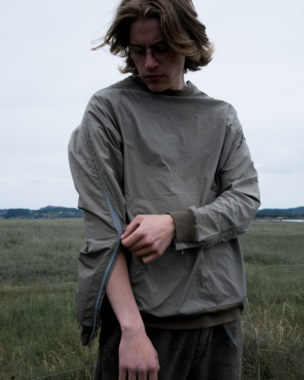 Nylon Popper Shirt, Olive. Behavior Fleece Pants, Khaki.