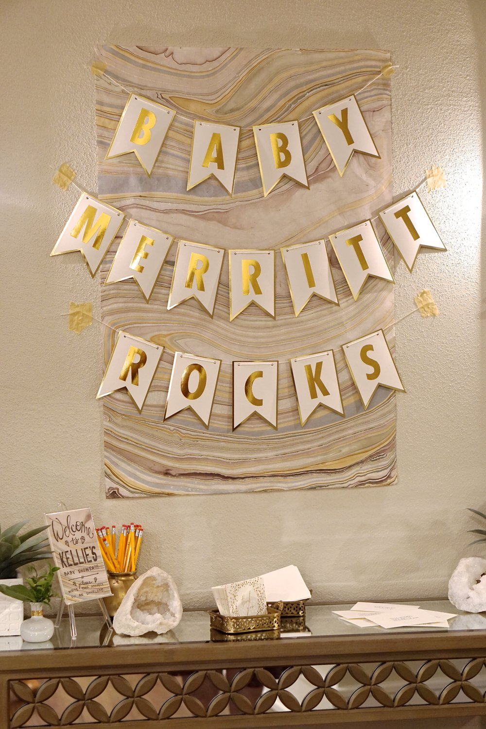 Gems + Geodes Baby Shower    Marbled papers, white crystalized geodes, fresh greenery, and an elegant color palette of earthy blushes, grays, and gold were the perfect feminine details for this gemstone-inspired baby shower for mom-to-be Kellie!