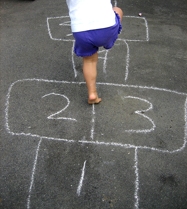 Child playing hop-scotch