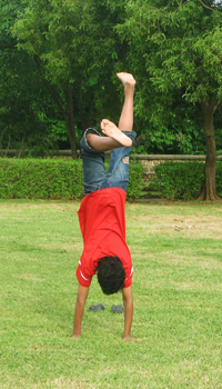 child doing a handstand