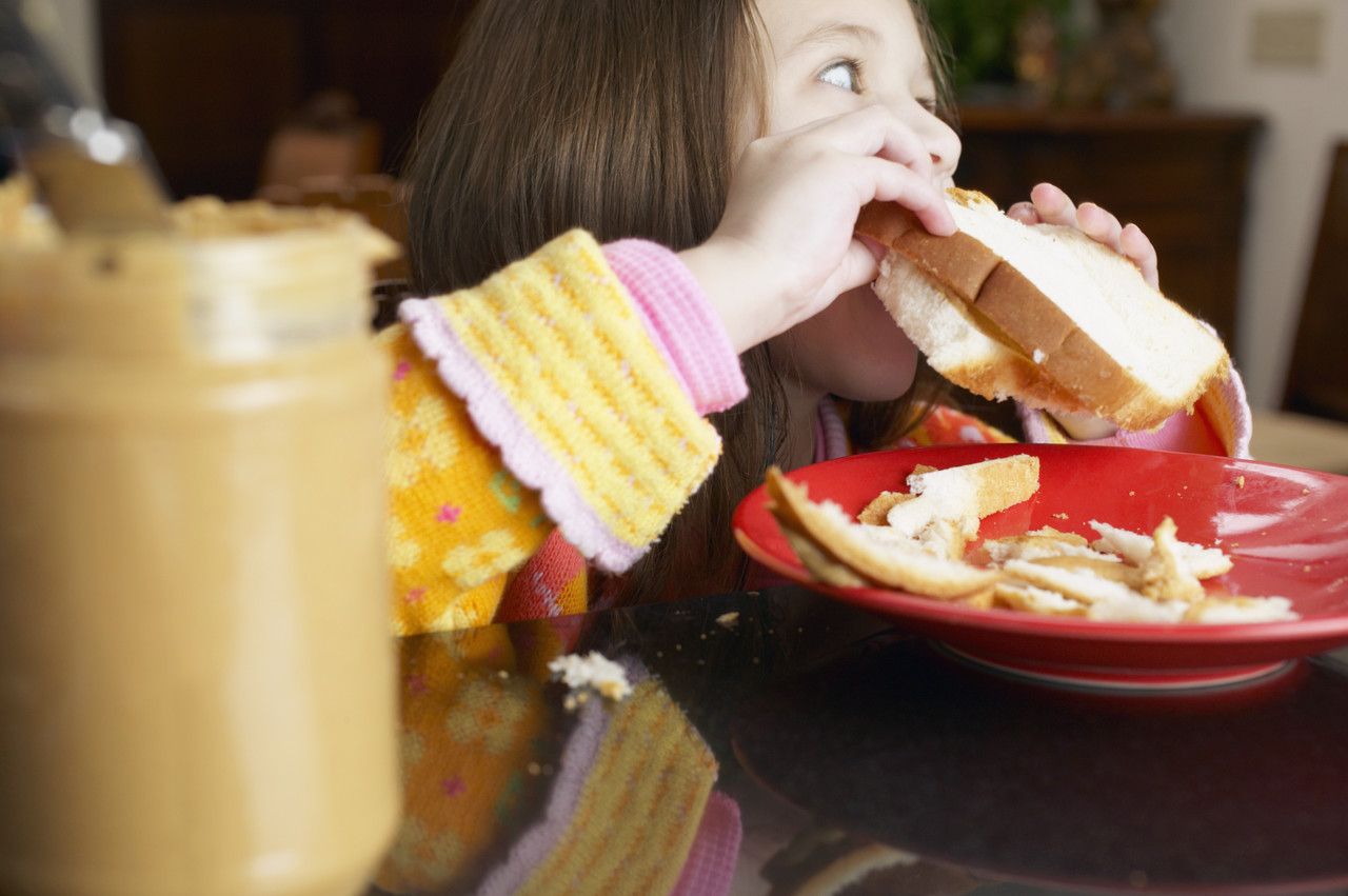 Girl Eating Peanut Butter Sandwich