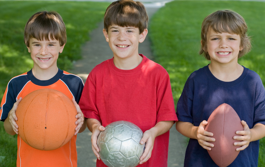 Three Boys Holding Sports Balls | Stock Image from Microsoft Office Images.