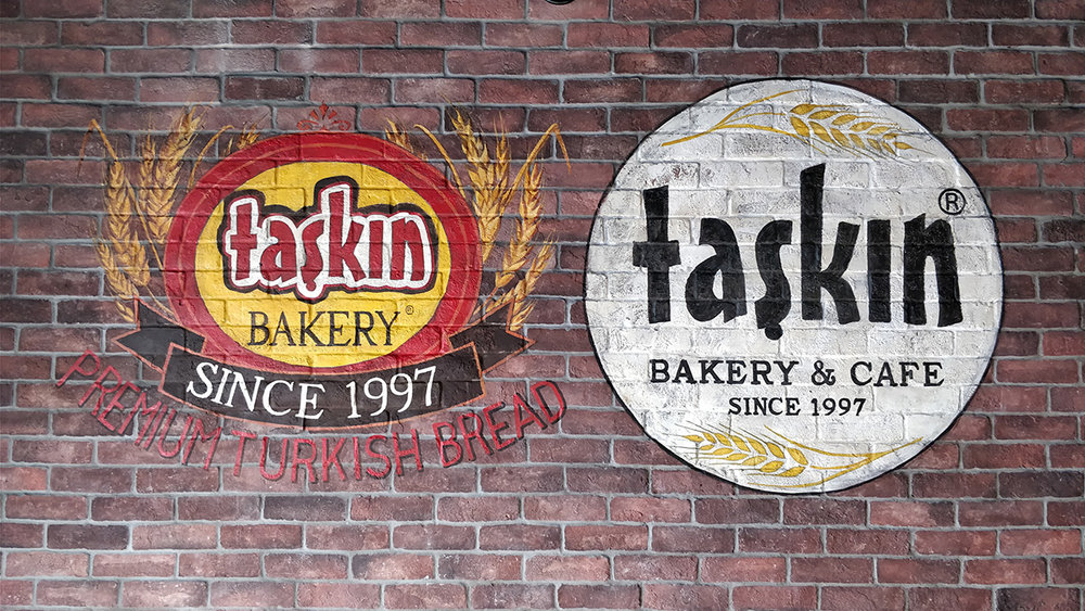 Taskin Bakery 2 Logos_Acrylic on brick_33 x 70 inch. (c).jpg