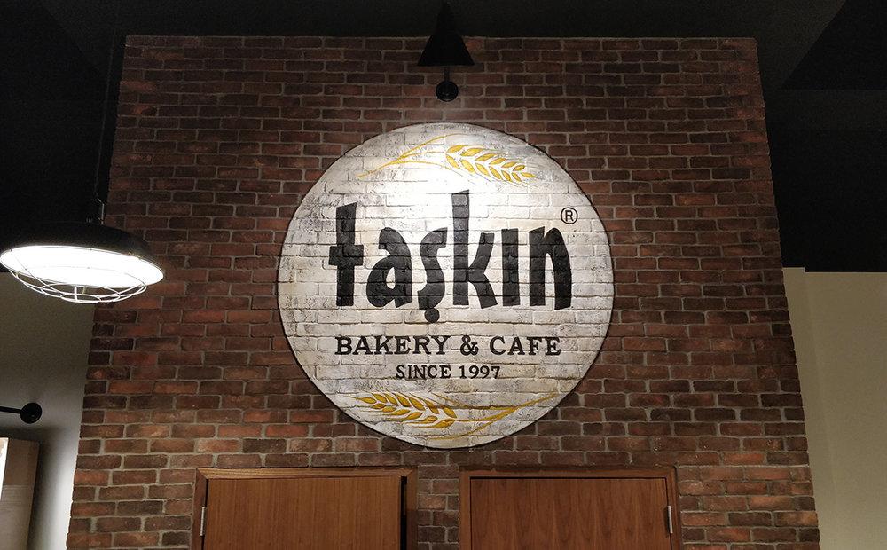 Taskin Bakery Logo_Acrylic on brick_diam 66 inch._2017.jpg