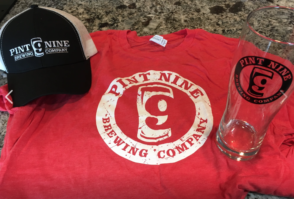 Merchandise available in the taproom. Sweatshirts, T-shirts, hats, keychains and a variety of glassware. All great to pair up with a Pint Nine gift card!