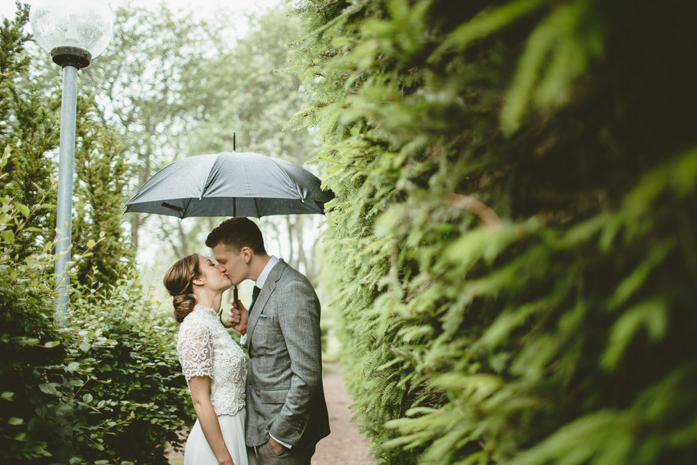 Portrait - Raining - Dominant hedges on the right close in on them, like they are sharing a moment away from everyone else