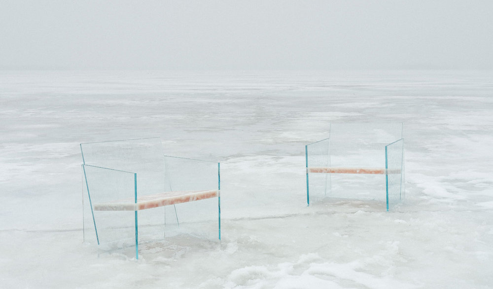 glass chairs in elevation on lake.jpg
