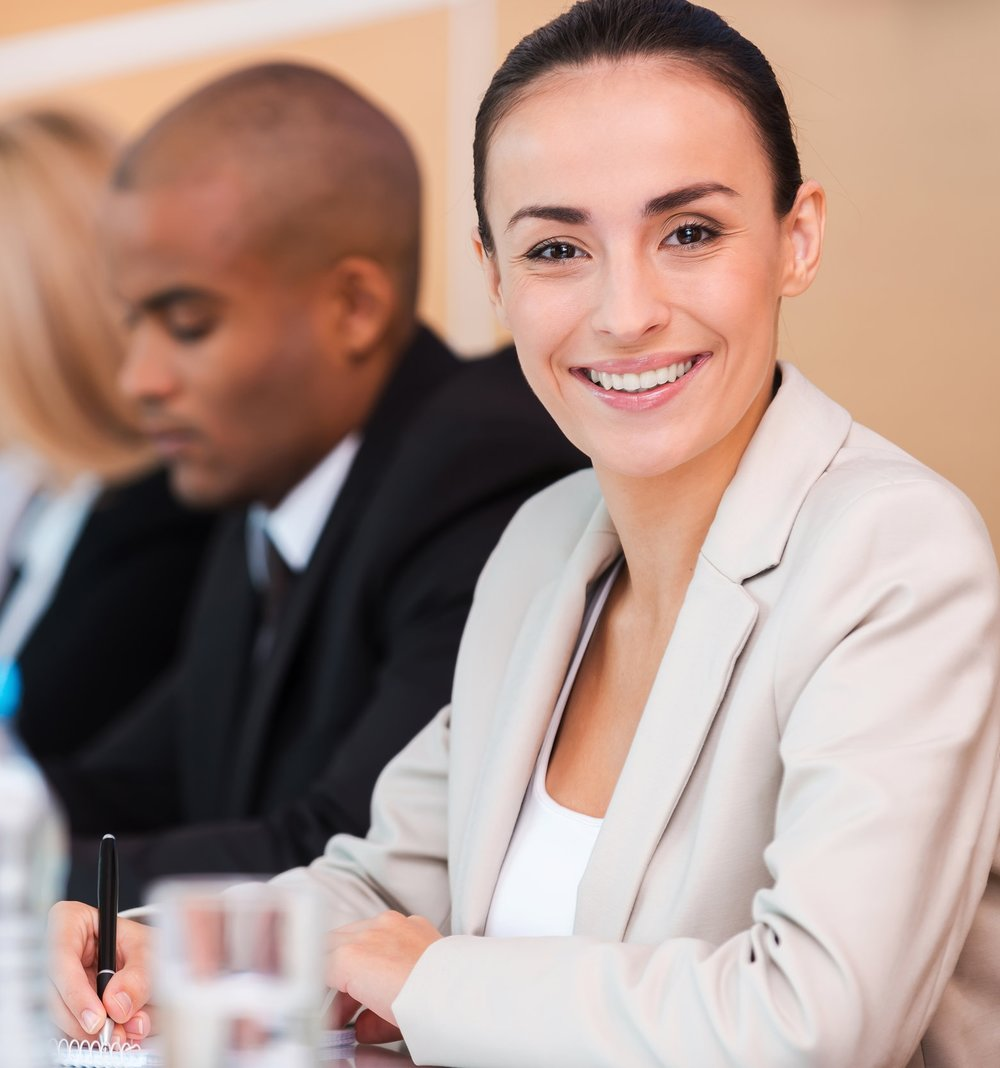 stock-photo-confident-business-expert-group-of-business-people-sitting-in-a-row-and-writing-something-in-their-217421482.jpg