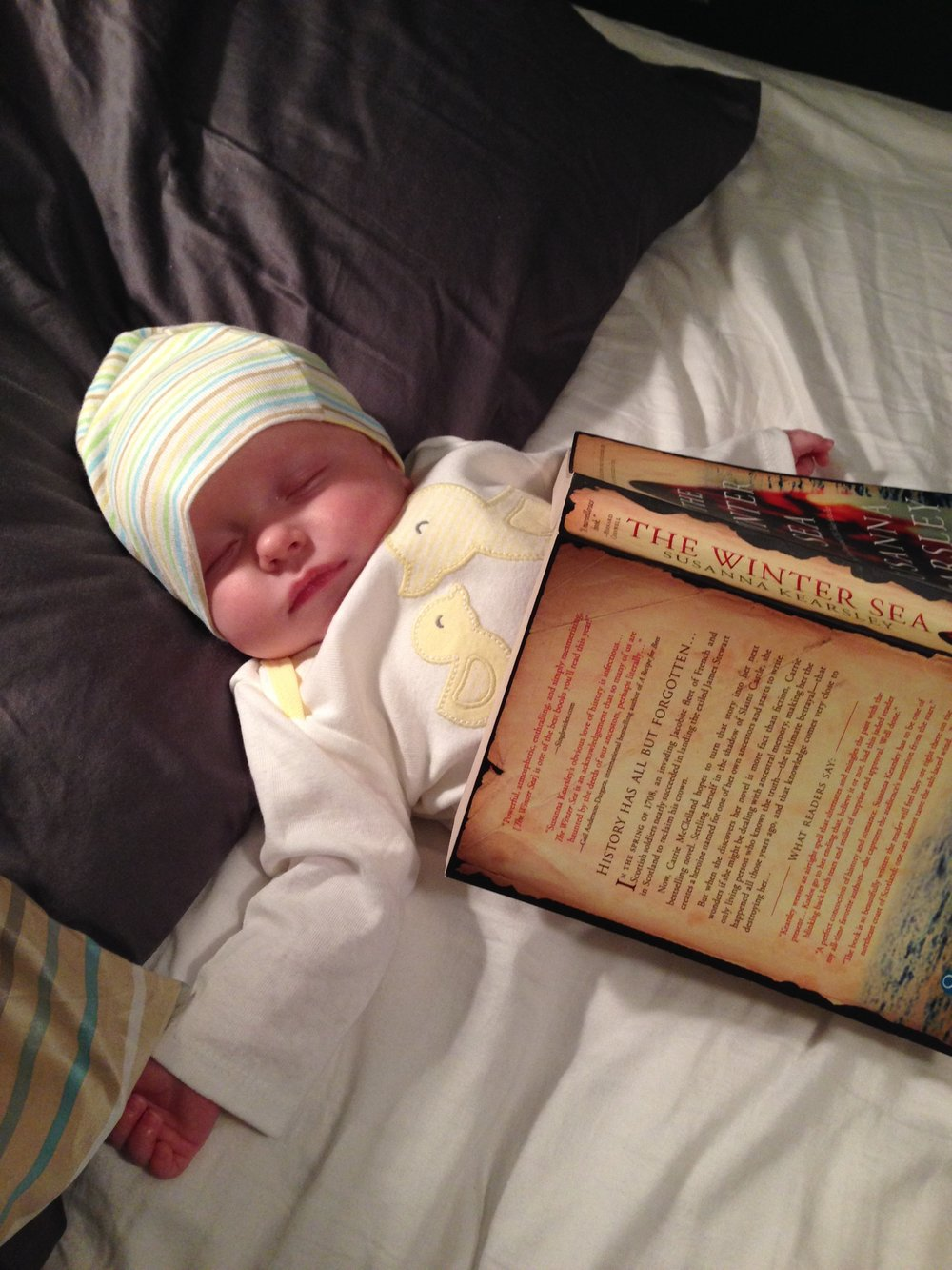 baby sleeping with book