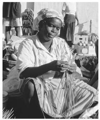 A market vendor examines onions in Castries. Saint Lucia.  Source: https://www.everyculture.com/No-Sa/Saint-Lucia.html . #SaintLucia #Caribbean #Afrocaribbean #Farmers #Vintage #Photography #StLucia #CaribbeanPhotography #VintagePhotograpy #BlackAndWhite