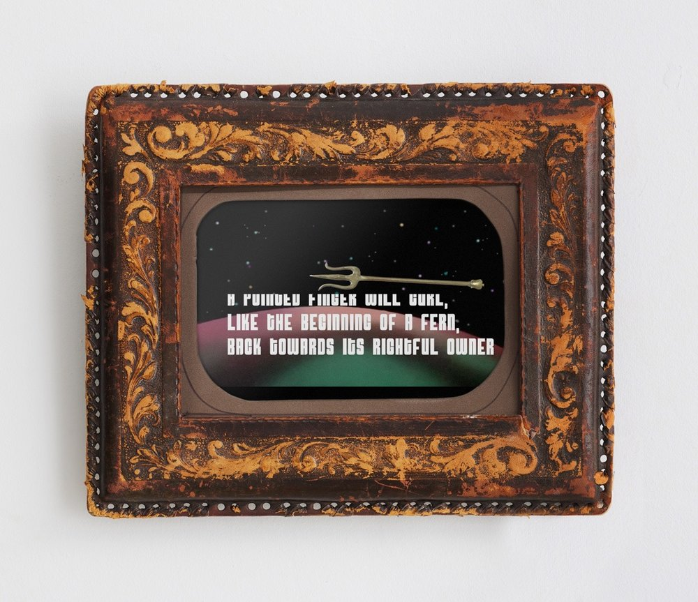 A pointed finger curls back to its rightful owner , 2012   Video, dedicated tablet, vintage leather frame, 10 x 6 inches