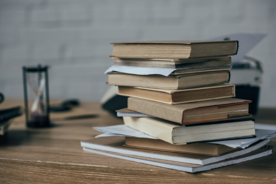 Part of my decluttering process is dealing with stacks of books. Let's talk about how stacking can actually help you --in the form of habit stacking.