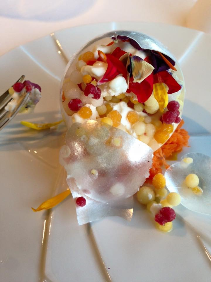 When we broke it open, this was inside: tiny beads of fruit sorbets and flower petals and cream...