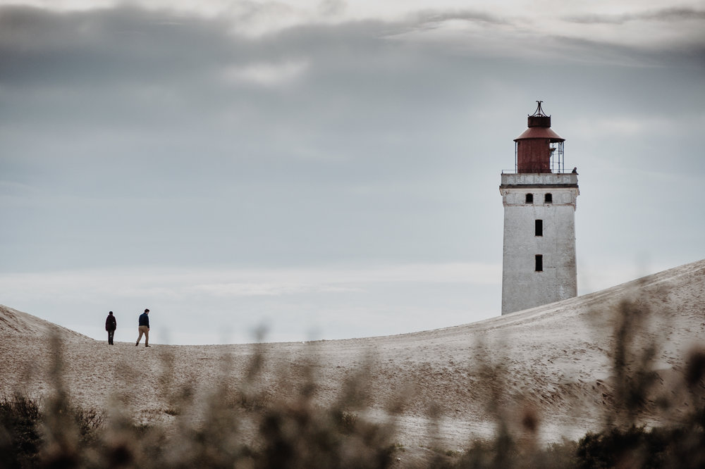 People walking up the dunes towards the lighthouse, seen from the trail leading into the dunes. Used my 18-200mm for this shot to create this interesting composition.