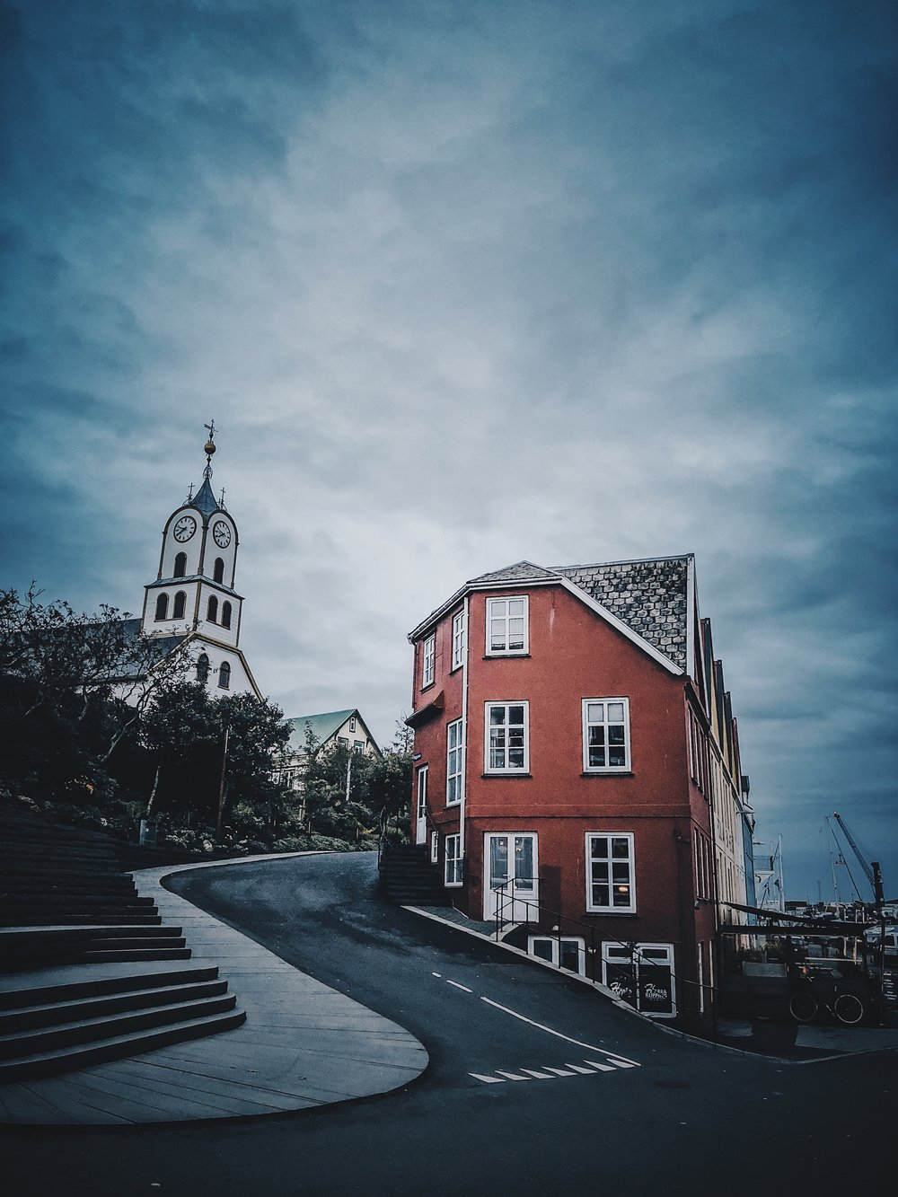 Very famous spot among photographers, in the heart of Tórshavn.  Tórshavn Cathedral  and Bryggjubakki street (left) and Undir Bryggjubakka street (right) at the centre of the city