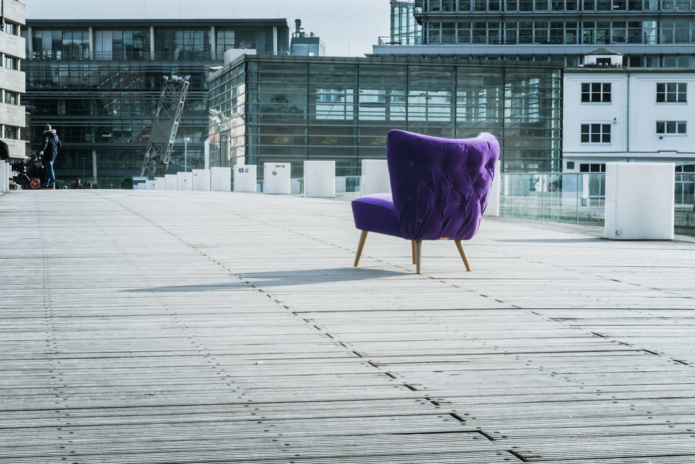 Purple chair in urban surroundings