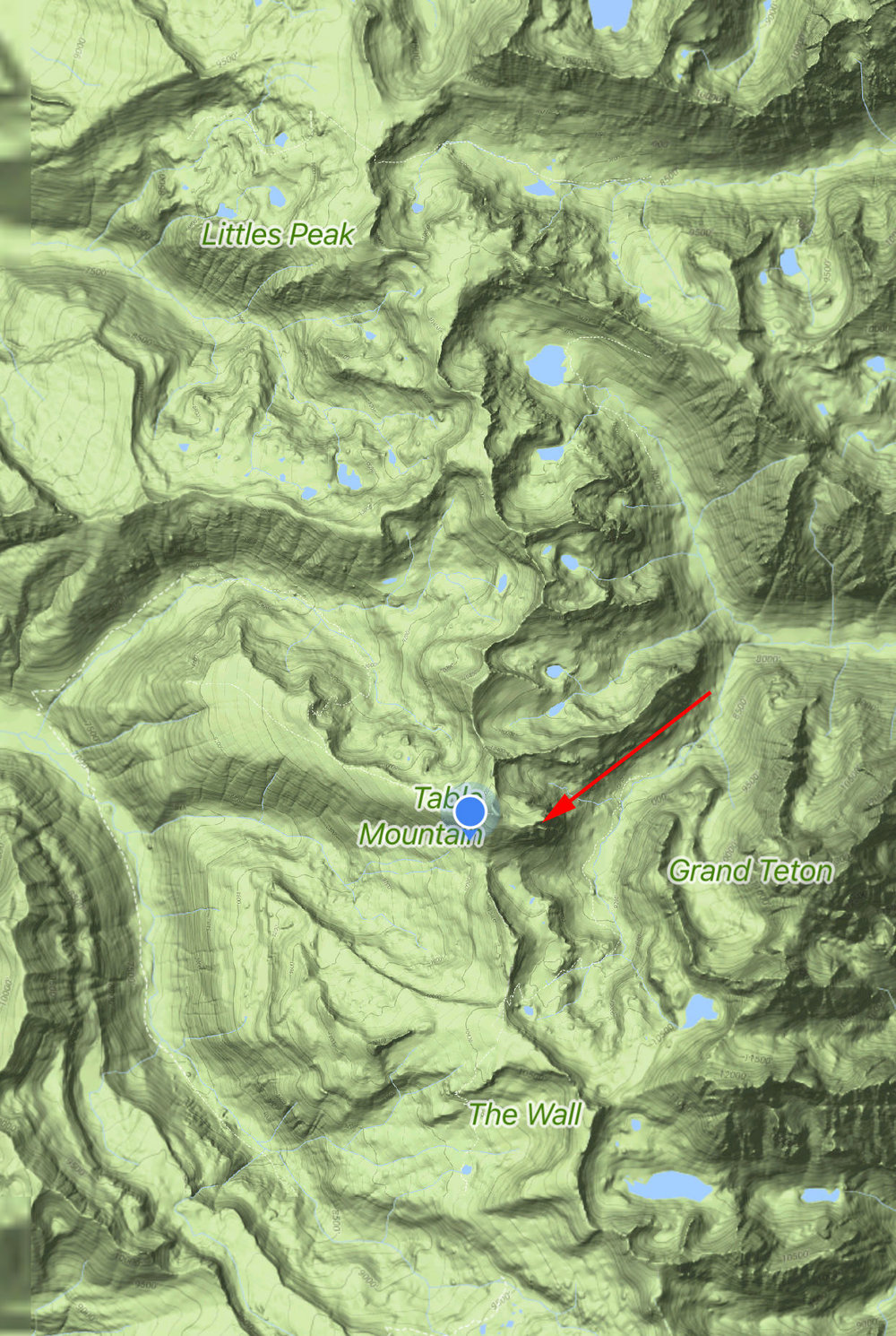 Blue dot is the peak of Table Mountain. Arrow is the cliff
