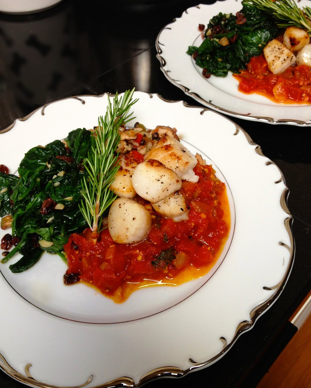 Scallops in Fire Roasted Tomato Saffron Broth w/Golden Raisin Garlic Spinach