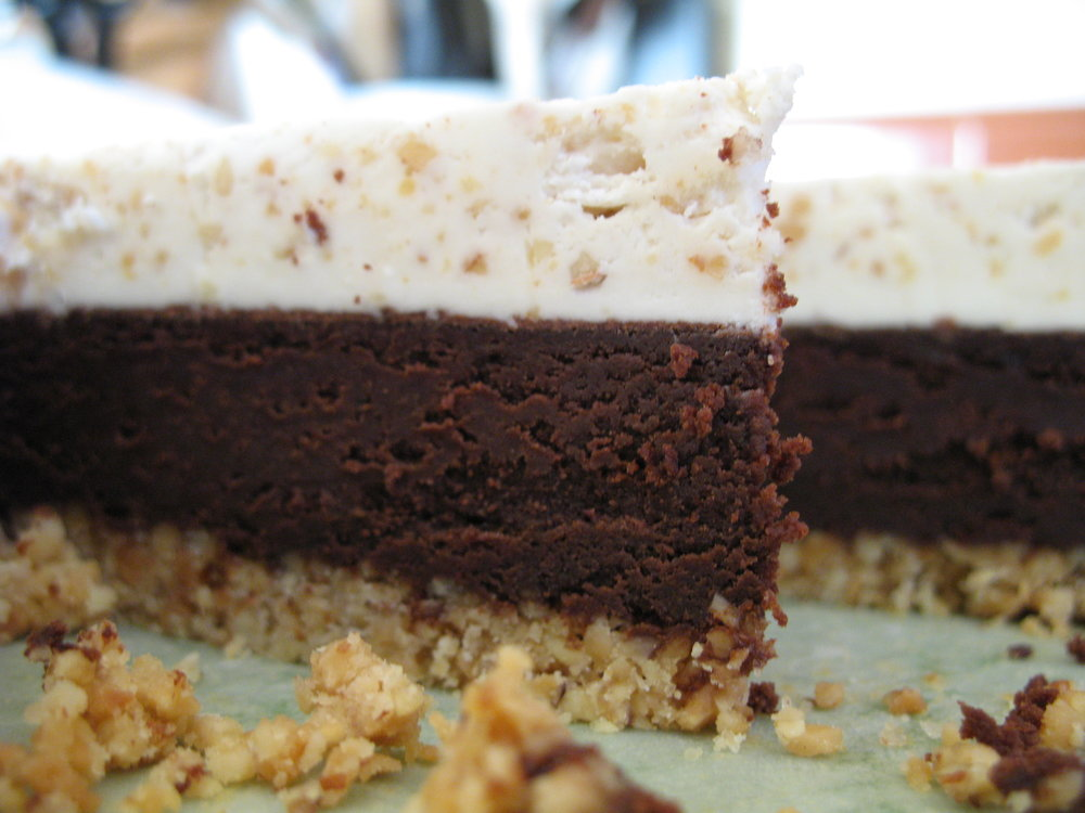 Almond Nut Crust with an Almond Scented Truffle Brownie Layer topped with Almond Icing