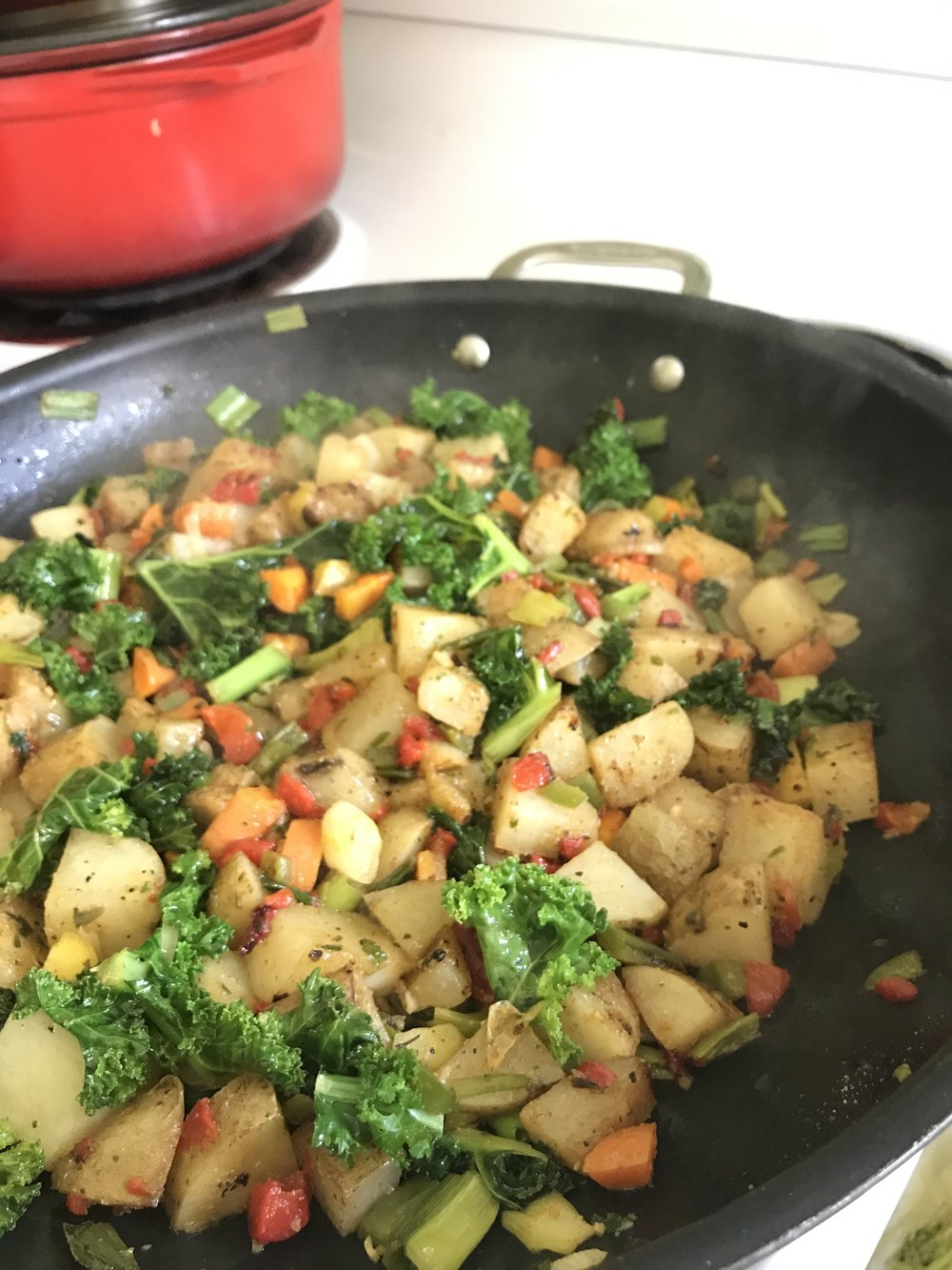 Added the scallions and green vegetables about halfway through cooking time, before the potatoes caramelized.