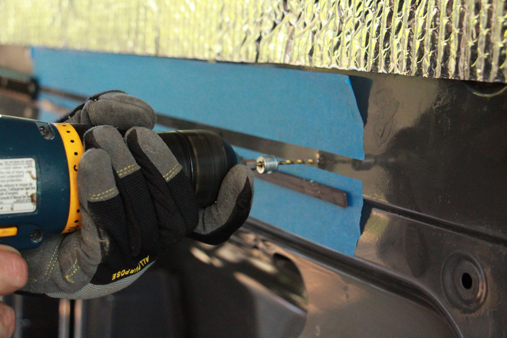 The stop collar on the drill bit was cheap insurance to prevent us from accidentally piercing the outer wall. In a pinch, a thin strip of duct tape wrapped around the bit is a better-than-nothing alternative.