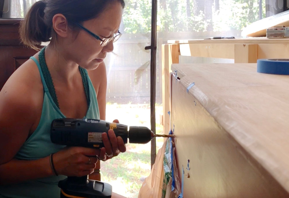 """Drilling 3/8"""" holes in back of counter (which we ended up widening later)."""