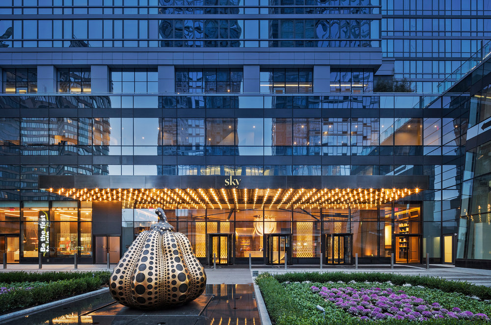 - SKY is continuing its stride with luxury and art, as part of the featured in the recent New York Times' Real Estate - Design Notebook article. One of our favorite images was used in the piece - the dusk shot of the entrance with Yayoi Kusama's Pumpkin in the foreground. read more