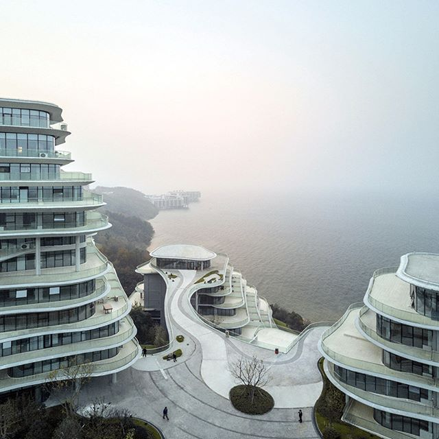 Architecture studio MAD has built a cluster of apartments in China's Anhui province, which take their forms from the mountain range's granite contours. The floorplates of each housing block decrease in scale towards the summit, blending into the environment of the Taiping lake. 📷: #MADstudio #dezeen . . . #architecture #architectural #apartments #nature #taipinglake #china #mountains #structural #natural #design #architecturedesign #instalike #instashare #architectureshare