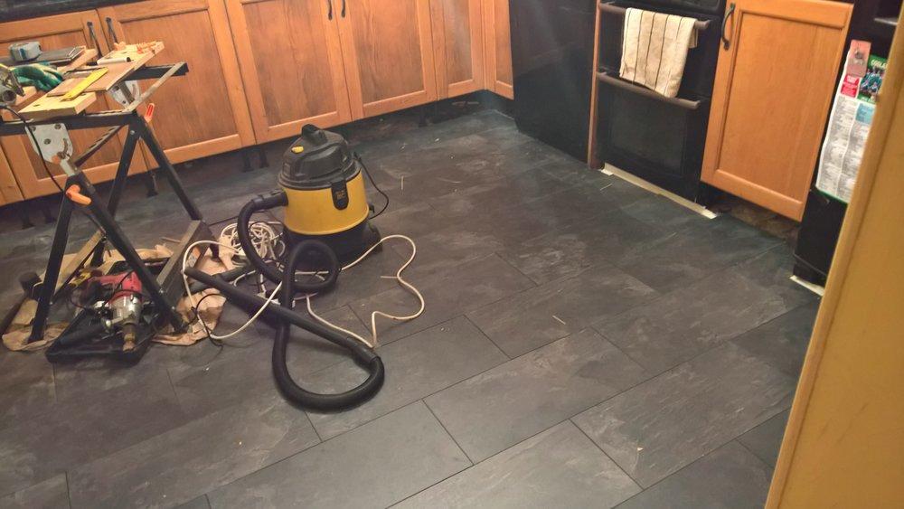Flooring in progress.